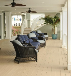 Deck with chairs, ceiling fans, and railing